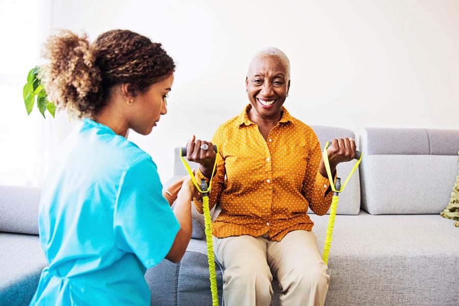 nurse helping patient exercise